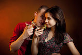 Young couple drinking martini — Stock Photo