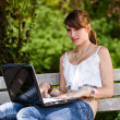 Beautiful girl using laptop — Stock Photo #3495835