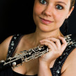 Young beautiful clarinetist — Stockfoto