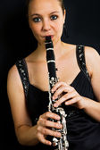 Young beautiful clarinetist — Stock Photo