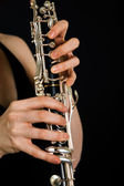 Playing on clarinet — Stock Photo