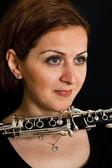 Beautiful clarinetist women — Stock Photo