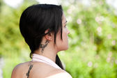 Beautiful yound women with tattoo — Stock Photo