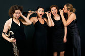 Four womens with clarinets — Stock Photo