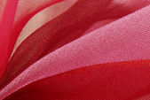Red pink organza fabric texture macro — Stock Photo