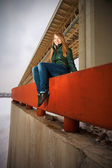 Woman sitting on parapet — Stock Photo