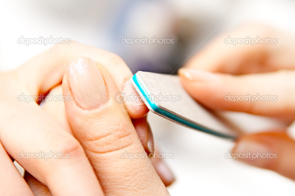 Studio nail - beautician polishing nails — Stock Photo #2756628