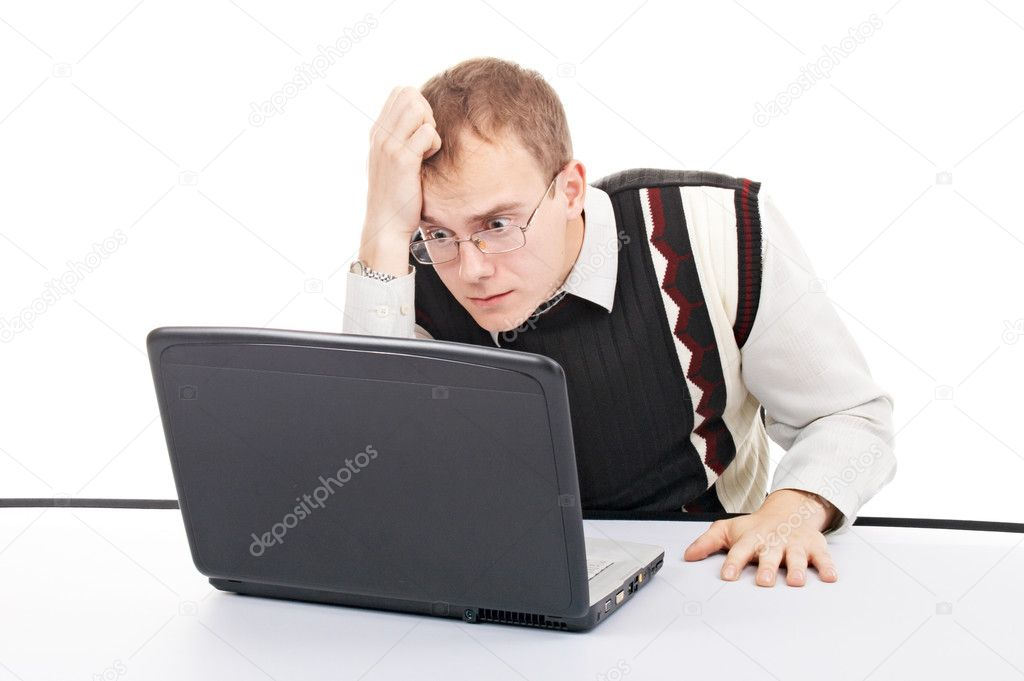 Pensive man with computer isolated in office  Stock Photo #2997128