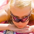Girl in sunglasseses takes solar baths — Stock Photo