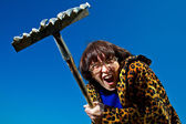 Woman with rake — Stock Photo