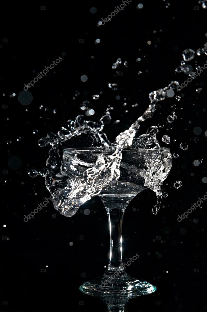 Splashes water in goblet on black background  Stock Photo #3144646