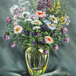 Glass vase with wild flowers — Stock Photo