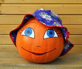 Pumpkin with female face in a children's hat — Stok fotoğraf