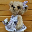 Teddy-bear Lucky before a wooden wall - Stok fotoraf
