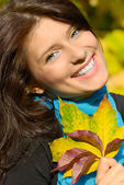 Girl with leaves — Stock Photo