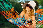 Woman in hammock — Stock fotografie