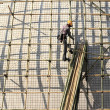 Building a scaffold with bamboo — Stok fotoğraf