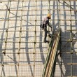 Building a scaffold with bamboo - Foto Stock