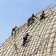Building a scaffold with bamboo - Stockfoto