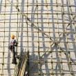 Building a scaffold with bamboo — Stockfoto