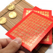 Red envelopes and coins — Stock Photo