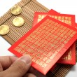 Red envelopes and coins — Stockfoto