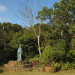 Kannon status in garden - Stock Photo