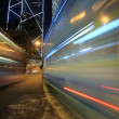 Bus speeding through night street. Hong Kong, Ch — Stock Photo