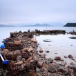 Wasted stuffs at the coastline — Stock Photo