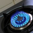 Gas burner with blue flame - Stock Photo