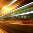 Foto Stock: Fast moving bus at night in Hong Kong