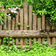Fence in garden - Stock Photo