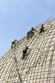 Building a scaffold with bamboo — 图库照片