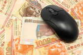 Using money online by mouse — Stock Photo