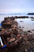 Verspild op kustlijn — Stockfoto