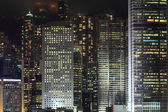 Details of business buildings at night — Stock Photo