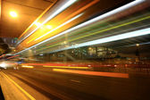Fast moving bus at night in Hong Kong — Stock Photo