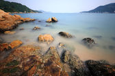 Coast with rock, very long exposure — Stock Photo