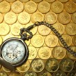 Pocket watch on money background — Stock Photo