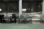 Old chairs in sport court — Stock Photo
