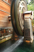 Wooden waterwheel is rotating — Stock Photo