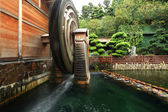 Wooden waterwheel rotating — Stock Photo