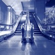 Escalator in blue tone - Stock Photo