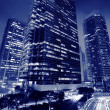 Skyscrapers business center at night - Stock Photo