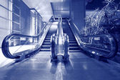 Escalator in blue tone — 图库照片
