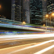 Traffic in business district at night — Stock Photo