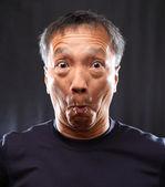 Mature chinese man shocked — Stock Photo