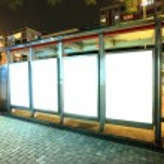 Billboard on bus stop at night — Stock Photo