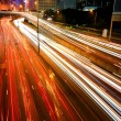 Blurs of night city traffic streams — Stock Photo