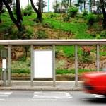 Blank advertising billboard on bus stop — Stock Photo